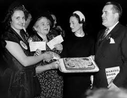 1950 Grand National Bake-Off, NYC The Duchess of Windsor, second from right, the former Wallis Simpson, congratulates winners of the Pillsbury Grand National Bake-off. From left are Mrs. Bernard Derousseau of Rice Lake, Wis., who won a $5,000 first prize in a junior division of the bake-off, and Mrs. Peter Wuebel, of Redwood City, Calif., winner of the $25,000 first prize in the bake-off. The women are joined by Philip W. Pillsbury, president of Pillsbury Mills, who along with Wuebel, holds the