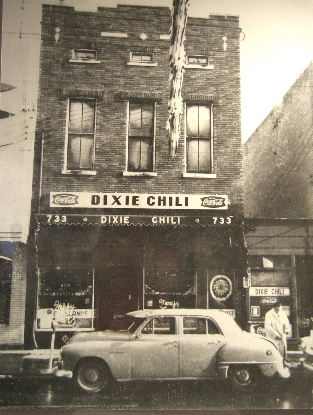 Vintage photo of Dixie Chili Parlor in Newport, KY.  The original location was the smaller building on the right side.  Photo courtesy of Dixie Chili.