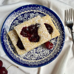 cherry squares dessert on blue polish pottery plate