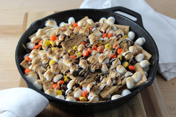 Peanut Butter Skillet S'mores Nachos - Baked and Drizzled with chocolate and peanut butter sauce