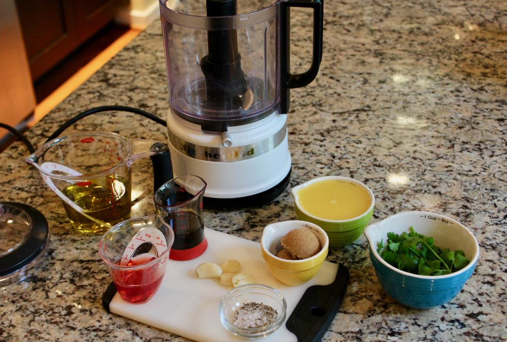 Marinade Ingredients measured and displayed with 5-cup KitchenAid chopper