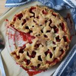 Strawberry Rhubarb Pie with Star Crust, slice cut out