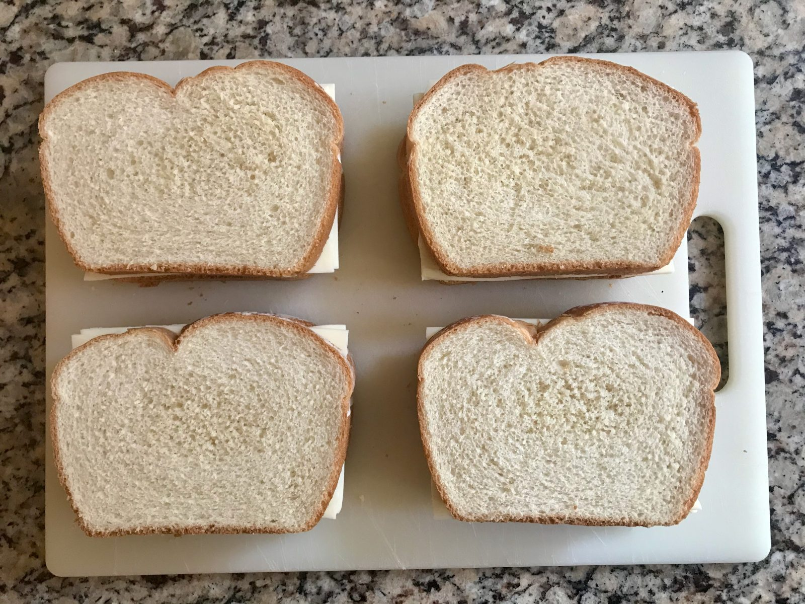 4 assembled uncooked gresilled cheese sandwich