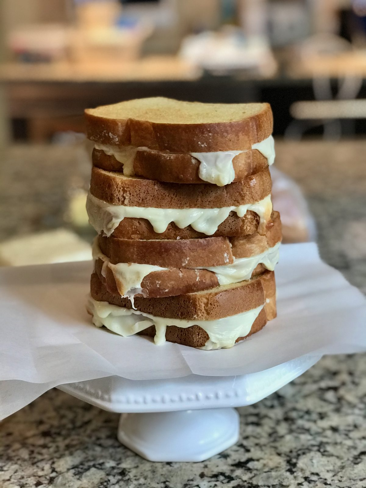 Stack of 4 golden brown grilled cheese sandwiches